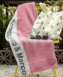 pink towel on chair